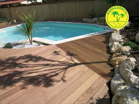Un bois spécifique ? Votre artisan décorateur paysagiste Espacedéco intervient dans la réalisation de tour de piscine.